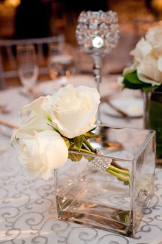Wrap a few creamy white roses in rhinestones and prop them in a simple square vase. Or any other flowers Flower Centerpieces, Wedding Centerpieces, Wedding Decorations, Centerpiece Ideas, Flowers Decoration, Perfect Wedding, Our Wedding, Dream Wedding, Wedding Table