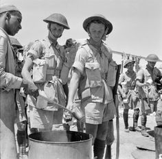 Troops queue for a mug of tea at an Egyption port, while waiting to embark on ships bound for Sicily - 12 July 1943