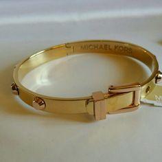 Authentic Michael Kors Hinged Bracelet Beautiful and rare piece by Michael Kors.  This bracelet is adjustable . Michael Kors Jewelry Bracelets