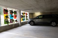 Hanging flower pots in the car park Hanging Flower Pots, Car Parking, Outdoor Ideas, Bloom, Pockets, Wall, Green, Flowers, Royal Icing Flowers