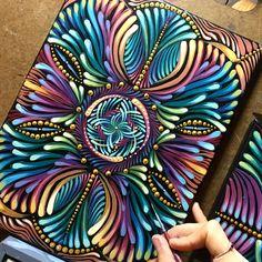 Kaleidoscopic mandala painting in progress.