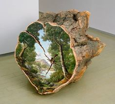Artist Alison Moritsugu uses trunks of fallen trees as canvas for her oil paintings. She represents, on the cut side, little windows on the nature that could show the places where these trees could have lived. The artist give another life to her materials by giving them a second nature.