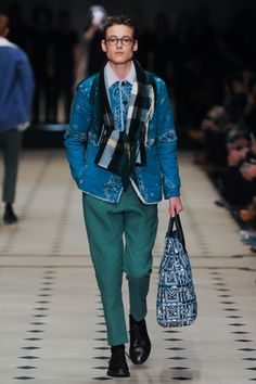 The last thing the ushers at Burberry did, just before the show began, was to close the tall, bronze velvet curtains that lined the tent. It was a simple but dramatic move, shutting off the grey Ja...