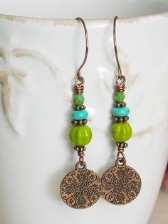 There is something about this color combination that I love. Turquoise blue and Chartreuse green are so beautiful with the genuine oxidized copper and flows together like a bride and groom. These are perfect for bonfires and marshmallow roastings. Pair these with your favorite maxi dress or jeans to complete your look. •Czech glass beads •Hand forged copper earwires. •Brass •Copper Charms •Handmade in the USA