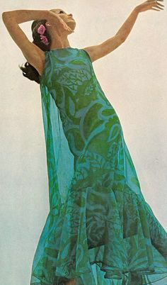 Veruschka in a flounced blue and green cage of organza over silk crepe by Oscar De La Renta for Jane Derby, photo by Bert Stern, Vogue US 1966