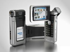 Nokia N90, the first phone to feature a camera with a carel zeizz lens. This is a first because zeiss lenses are known to be in large devices like cameras and optical devices. A first of this truely remarkable technology