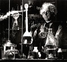 Ten bucks says it's that brain in the jar that's the mad scientist. The whack-job with the crazy hair is just his assistant.... A mean how can you dominate the world without any hands???