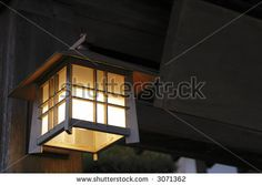 Specific Japanese wooden lantern at the entrance in a wooden building.