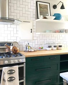 A big trend in the kitchen design world right now are deep green cabinets. Below, we rounded up our favorite deep green paint colors for you. Do you have a favorite green paint color? Bohemian Kitchen, Rustic Kitchen, Kitchen Dining, Kitchen Decor, Kitchen Stuff, Kitchen Furniture, Green Kitchen Cabinets, Kitchen Units, Kitchen Cabinetry