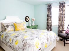 Another beautiful bedroom from HGTV's gallery. A nice pop of color in the corner from the emerald green table!