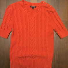 Orange Banana Republic sweater Half sleeve sweater with gold exposed buttons on one shoulder. Size is Petite Medium. Banana Republic Tops