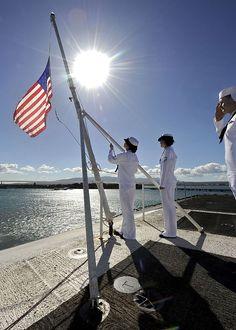 Sailors raise the national ensign aboard the aircraft carrier USS Nimitz (CVN-68). #americasnavy #usnavy