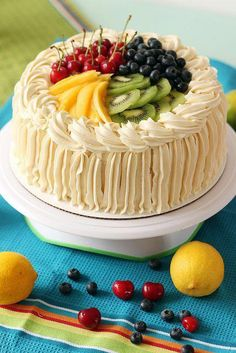 Gorgeous summer white cake with lemon curd filling and decorated with fresh fruit. Rodjendanske Torte, Fruit Cake Design, Fresh Fruit Cake, Fruit Cakes, Cake Recipes, Dessert Recipes, Lemon Curd Filling, Cake Toppings, Occasion Cakes