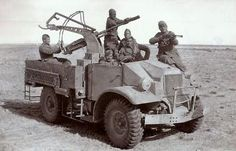 Italians soldiers pose with their captured Chevrolet/Ford built CMP track with a mounted anti aircraft gun while serving in Tunisia. CMP stands for Canadian Military Pattern Big Trucks, Ford Trucks, Pickup Trucks, North African Campaign, Italian Army, Afrika Korps, World War Ii, Military Vehicles, Wwii