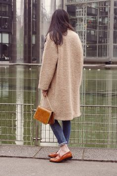 A knitted Zara coat, cuffed jeans, and comfy loafers. Cute little purse too!