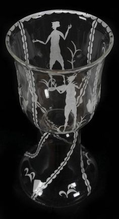 """An etched glass """"pokal"""" cup designed by Dagobert Peche and Mathilde Flogl and produced by the Wiener Werkstatte, Vienna, circa 1920. Peche (1887-1923) joined the Wiener Werkstatte as artistic director in 1915. He is credited for ushering in a """"New Era"""" for the decorative arts. Flogl (1893-1950) was a textile designer who joined the Wiener Werkstatte in 1916. She was influenced by and sometimes collaborated with Peche."""