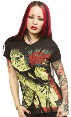 "THE MUMMY GIRLY TEE    Oh what a fright you will give in the Universal Mummy tee from Rock Rebel! This fantastic fitting girly tee features ""The Mummy"" in all his undead glory. 100% Cotton.  Rock Rebel Size Chart    S 32"" bust    M 34"" bust    L 36"" bust    XL 38"" bust    $25.00"
