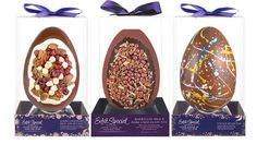 Asda's premium egg range displayed in a clear box resting on a purple plinth and topped by a regal purple bow.