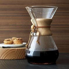 Get back to coffee-brewing basics with the Chemex classic, originally designed by a chemist and inventor and found in the collections of several major museums. Simple engineering in wood and glass (no corrosive elements) produces pure drip coffee with less bitterness—to the extent that the coffee can be refrigerated and reheated without sacrificing flavor. Polished wood collar with insulating leather tie is removable for cleaning. May also be used for tea, iced coffee and beverage infusions.