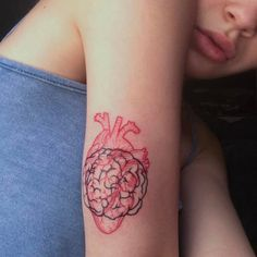 Anatomical heart and brain tattoo on the back of Bea Miller's right arm.