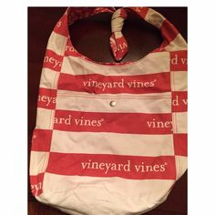 Vineyard Vines Reversible Tote Vineyard Vines Reversible tote. Has one side with pocket that's perfect for holding your cell. It's knotted at the top but can be unknotted to become longer or shorter. One side has VV's and the other has sea horses. Perfect school bag. Comes with VV whale sticker :) Vineyard Vines Bags