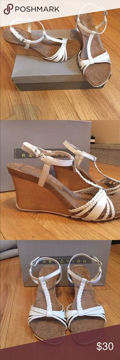 Kenneth Cole - Cork and Leather wedges. Size 9. Kennet Cole REACTION. Cork wedges with white leather braided straps. Size 9. 2 inch wedge. ONLY WORN ONCE!!!!! Kenneth Cole Reaction Shoes Wedges