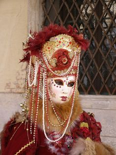 Gorgeous red and gold.  Venice Carnival 2014 by Lesley McGibbon