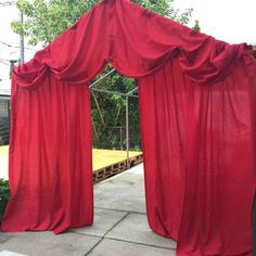 This is just a picture, but it looks like they just hung red sheets to create a carnival or tent looking entrance. This would look GREAT to frame the classroom door OR put it along one wall in the classroom as a giant decor prop!