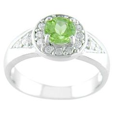 Take my current engagement ring and surround it with emerald stones