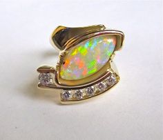 Custom created opal and diamond ring by Glenn Dizon Designs, www.glenndizon.com.  Let me create the piece of your dreams for you.