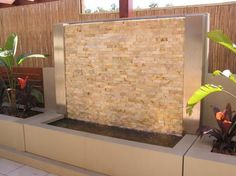 Stacked Stone Clad Water Feature. Free standing. Paint rendered. Ideal for courtyard or patio