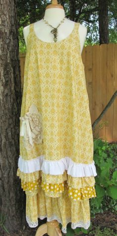 """We call this the """"Charlie"""" dress. Gorgeous gold and cream print with three layers of coordinating ruffles along the bottom and a vintage crochet pocket. Bloomers in a coordinating fabric also available. Available to order in S-Plus"""