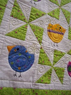 Chubby Chicks Baby quilt. Love the quilting, especially the swirls above the birds tails.