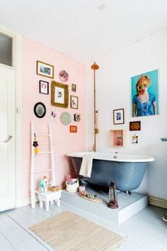 Pink walls and a gallery wall in the bathroom - in a fabulously quirky Dutch home. Hans Mossel / Sabine Burkunk.