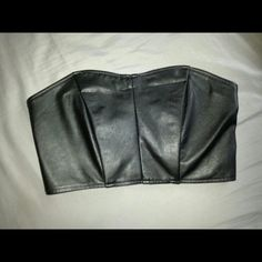 "Forever 21 Black pleather tube crop top Length Measurement front the back is 5.5"" long.  Secure hook on the back with 3 buttons. Elastic from the back.  Worn once Forever 21 Tops Crop Tops"
