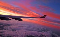 © Peter Byrne/PA. MANCHESTER, UK. A general view of the sunrise from the window of a Virgin Atlantic plane landing at Manchester Airport on Oct. 4, 2016.