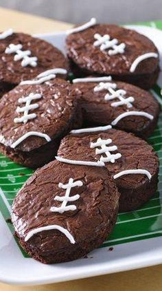 "You're sure to score many points with the football fans in your life once these football-shaped brownies hit the snack table. This creative game-day dessert is as easy as making boxed brownies—all you need is a football-shaped cutter (or a knife if you want to freestyle it) and some icing for the ""laces."""