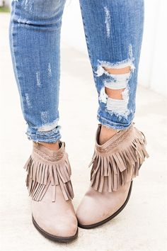 These fall fringe booties are PERFECT. They feature a fringe layered shaft with faux suede material. The heel height is approximately 2.25\