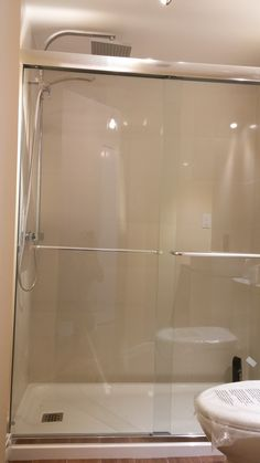 New shower enclosure with sliding tempered glass doors : Bathroom design, custom furniture design and renovation by ATYPIK INTERIOR DESIGN. You can now see the photos ''Before'' and ''After'' of this space and some technical working drawings.