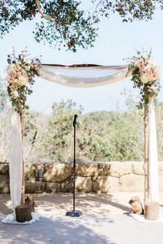 Flower accented arch with silver birch branches. Super dreamy plus