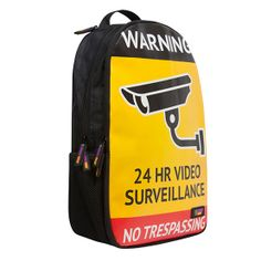 """'Big Brother' loud and proud scratch proof backpack from Urban Junk.  A black Back Attack rucksack, inspired by tech, culture and urban street life, 'Big Brother' is a play on signs of surveillance. Yellow backdrop with a black ,white lined CCTV camera with slogan """" 24HR Video Surveillance"""" just like the signs. Above is a larger WARNING! slogan in black and white and below written in white """"No Trespassing."""" Complete with 'Urban Junk' branding in the bottom right hand corner."""