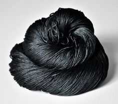 $32  Gorgeous deep black silk!  Poltergeist OOAK- Silk Yarn Fingering weight. €23.50, via Etsy.