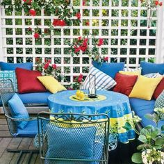 Lattice panels screen wind and lend privacy to this deck while flowering climbers soften their look and add color. | Photo: Jerry Pavia | thisoldhouse.com