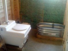 Tiny Bathroom - composting toilet and galvanized bath tub. Tiny House