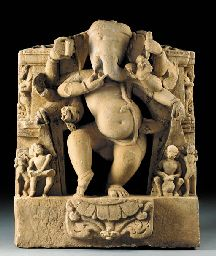 A Sandstone Figure of a Dancing Ganesha  India, Madhya Pradesh, 10th/11th Century  The potbellied deity carved in openwork dancing on a lotus pod, reaching out to a bowl of sweets with his trunk and flanked by musicians, his face with a humorous expression 39½ in. (100.3 cm.) high
