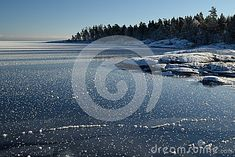 Frozen Lake shoreline on a clear Winter day, snow-covered rocky shoreline and shiny blue ice surface and with white snow and ice pieces. RAW file available. Shoreline Lake, Stony Brook, Snow Images, Clear Winter, Snow And Ice, Lake Superior, Winter Day, Great Lakes, Toronto