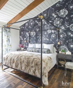 Black and White Floral Wallpaper Accent Wall in a Master Bedroom