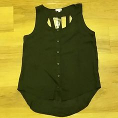 "NWOT Black Sheer Button Down Tank Zenana Styles Black Sheer Button Down Tank Top. New without tags but the extra button is still tagged to it. Cute open in the upper back of tank. Size Medium. 100% Polyester. When laying flat: front length is approximately 24"" long, back is 27"" long. Across chest from armpit to armpit is approximately 18"". No rips, tears, or defects. Comes from a smoke free home. Zenana Styles  Tops Button Down Shirts"