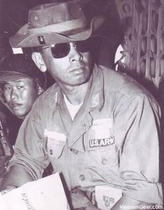 Captain David Helela, MAAG Advisor, with members of the Vietnamese 21st Division aboard a CH-21 helicopter travelling to a combat drop zone.    Photo taken: February 1963
