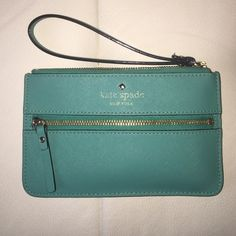 Kate Spade wristlet Teal, Kate Spade wristlet. Perfect for throwing cash/cards in when you're on the go! Slightly worn, but still in good condition. Make me an offer! kate spade Bags Clutches & Wristlets